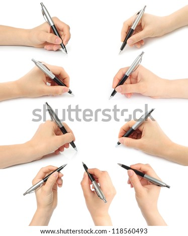 Collage of hands with pens on white background - stock photo