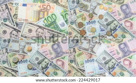 Collage of many different currency in coins and banknotes - stock photo