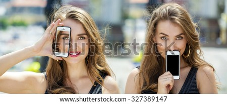 Collage two women, Young women covers her face screen smartphone on a background summer street - stock photo