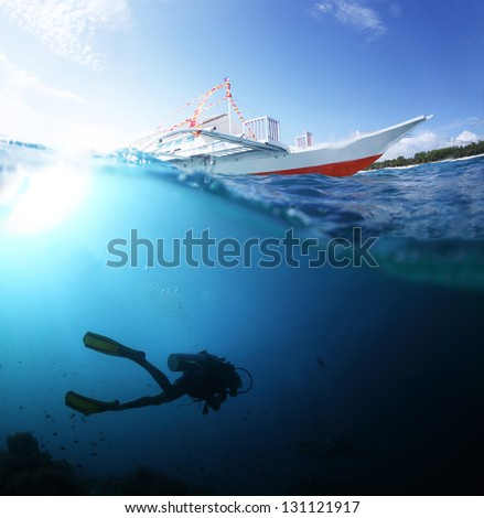Collage with scuba diver underwater and traditional boat on a surface at sunny day - stock photo