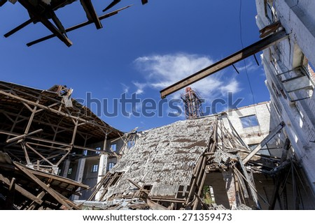 Collapsed roof in an old factory - stock photo