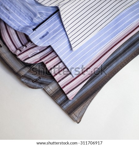 Collars of men's striped shirts - stock photo