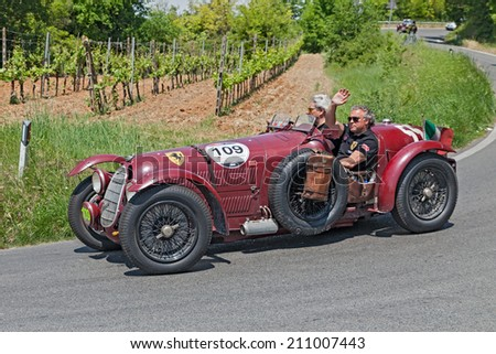 COLLE DI VAL D'ELSA, SI, ITALY - MAY 17: the crew Frans and Renee Van Haren on ancient racing car Alfa Romeo 8C 2900 A (1936) in rally Mille Miglia, on May 17, 2014 in Colle di Val d'Elsa, SI, Italy  - stock photo
