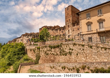 Colle di Val d'Elsa, Siena, Tuscany, Italy. View of the medieval town with city walls on the tuscan with city walls  - stock photo