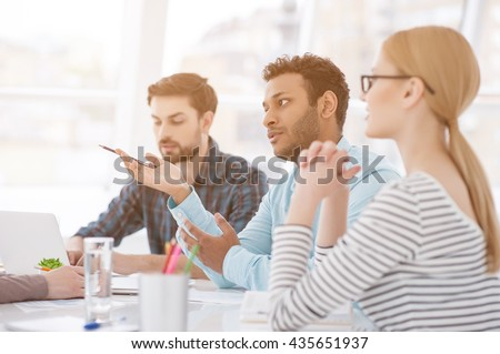 Colleagues at office meeting - stock photo