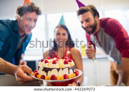 Colleagues celebrating a birthday in the office - stock photo