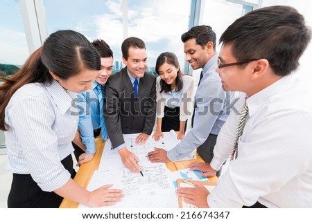 Colleagues discussing new business ideas - stock photo