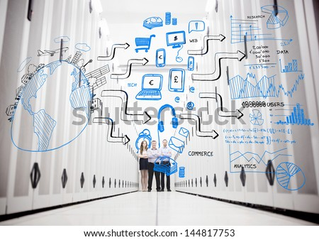 Colleagues in a data center standing in front of drawings of a planet with other sketches - stock photo