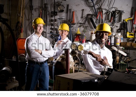 Colleagues in office maintenance area - stock photo