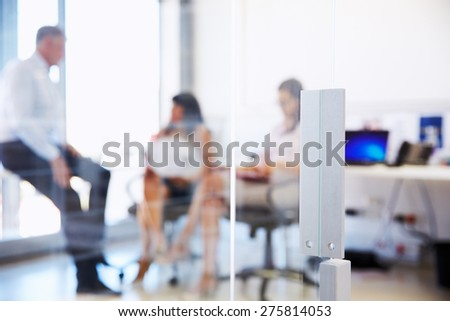 Colleagues talking in a modern office - stock photo