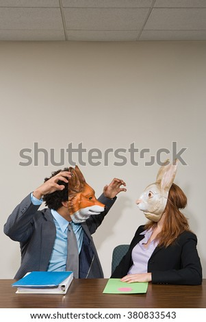Colleagues wearing masks - stock photo