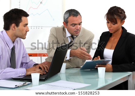 Colleagues working in an office - stock photo