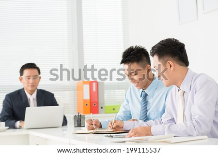 Colleagues working together - stock photo