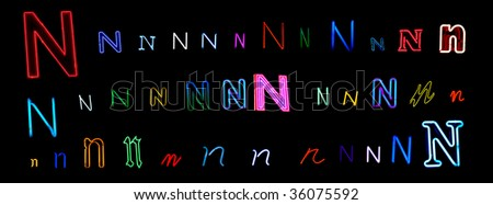 collection of a number of different neon letter N isolated on black - part of a series of neon letters - stock photo