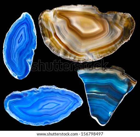 Collection of A slice of blue agate crystal with reflection on black surface background  - stock photo