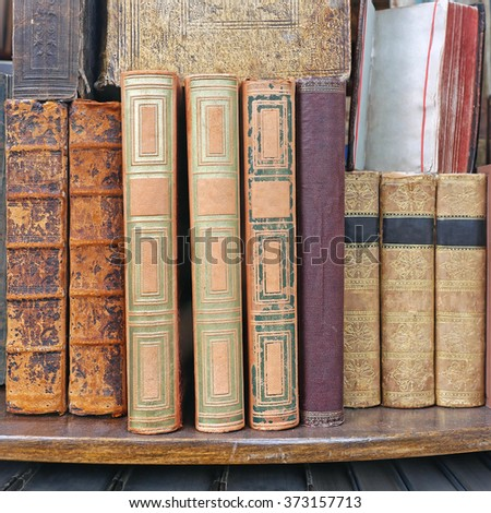 Collection of Antique Books at Book Shelf - stock photo