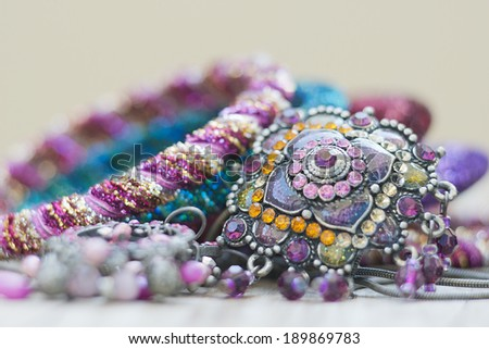 collection of assorted gemstone jewelery with stones, necklaces, rings, bracelets and chains - stock photo