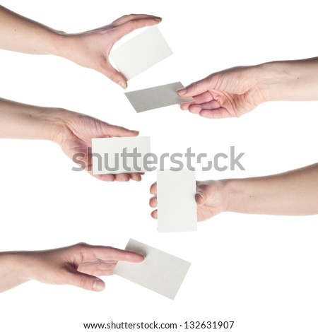 Collection of Beautiful woman hands holding an empty business card over white backgrounds. - stock photo
