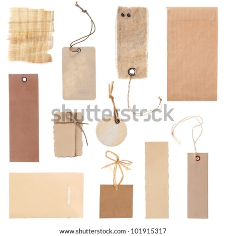 collection of blank cardboard paper labels or tag isolated on the white background - stock photo