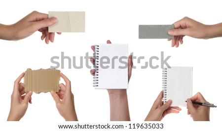 Collection of blank cards or note paper in a hand isolated on white. With path - stock photo