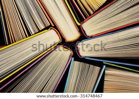 collection of books randomly positioned as seen from above - stock photo