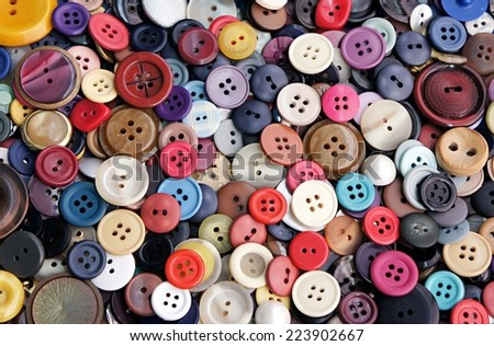 Collection of buttons of different colors and sizes - stock photo