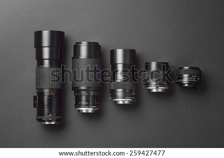 Collection of camera lens well organized over black background - stock photo