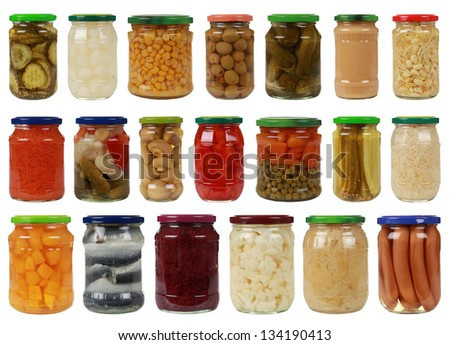 Collection of canned vegetables in glass jars, isolated on white - stock photo