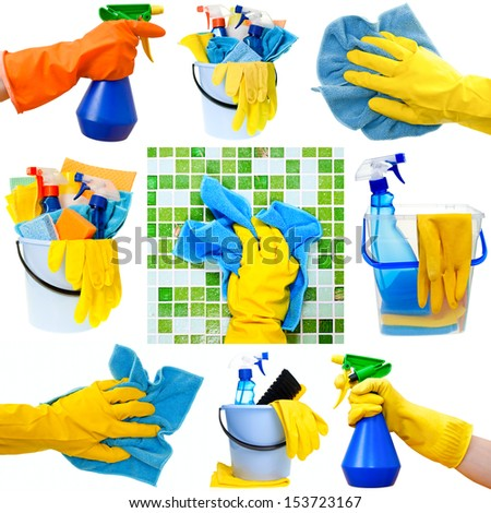 Collection of cleaning supplies on white background - stock photo