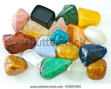 Collection of colorful polished semiprecious gemstones on white - stock photo