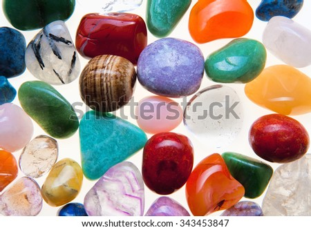 Collection of Colorful Semiprecious Gemstones on White. - stock photo