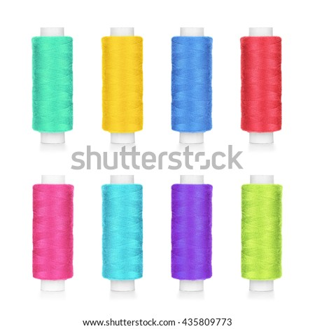 collection of colorful spools of thread isolated on white background - stock photo