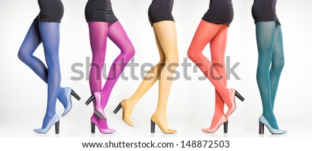 collection of colorful stockings on sexy woman legs isolated on grey - stock photo