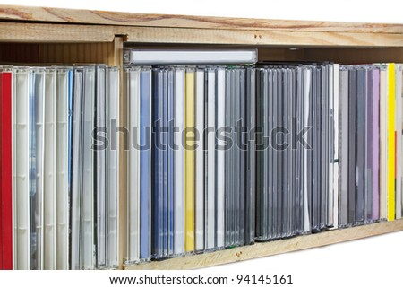 Collection of Compact Discs (CDs) in a shelf - stock photo
