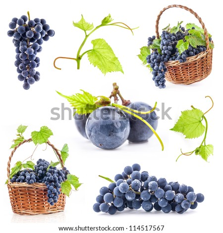 Collection of Dark grapes with leaves in a wicker basket, Isolated on white background - stock photo