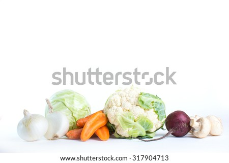 Collection of different varieties of cabbage and fresh vegetables on a white background. - stock photo