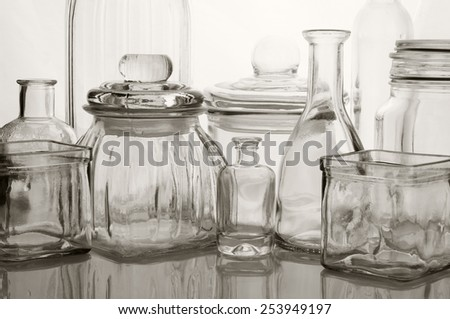 Collection of empty various glassware on light background. - stock photo
