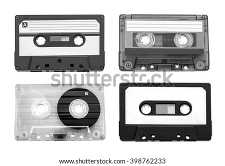 Collection of four plastic audio cassettes tape. Different colorful music tapes. - stock photo