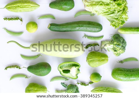 Collection of fresh green vegetables on white background - stock photo
