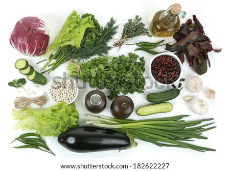 Collection of fresh green vegetables on white background, eggplant, parsley, white beans, parsley, beets, peppers, garlic, onions, cucumbers, red beans, thyme, salt, cabbage - stock photo