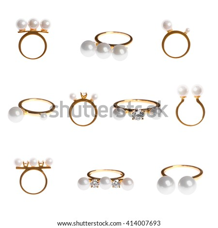 collection of golden pearl rings isolated on white - stock photo