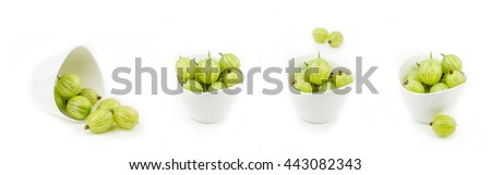 collection of gooseberries in white ceramic bowls on white background isolated - stock photo