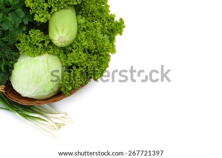 collection of green vegetables in a basket - stock photo