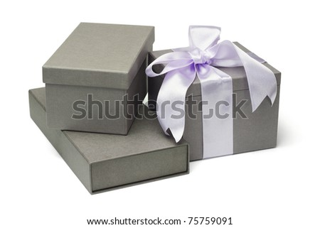 Collection of grey gift boxes on white background - stock photo
