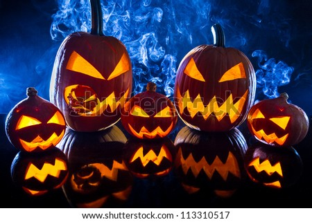 Collection of halloween pumpkin on black background - stock photo