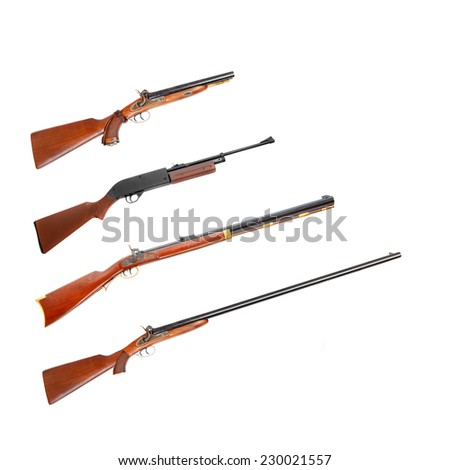 Collection of hunting rifles on white background. - stock photo
