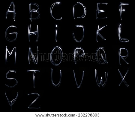 Collection of letters written with a flashlighgt isolated on black background - stock photo