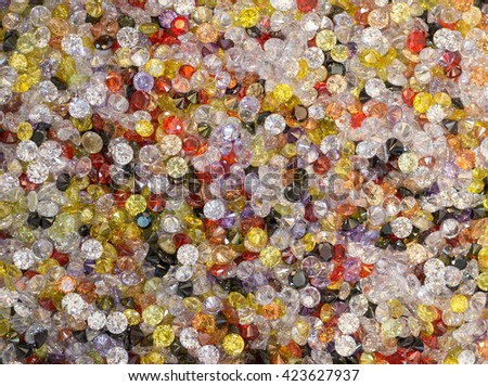 Collection of many different artificial gemstones background - stock photo