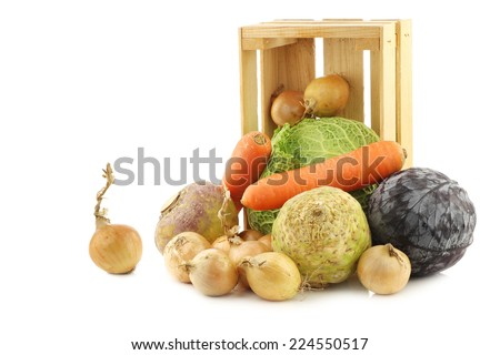 collection of many fresh winter vegetables in a wooden crate on a white background - stock photo