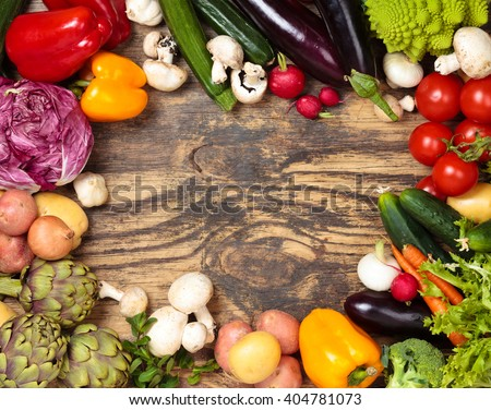 Collection of mixed organic vegetables and herbs on old wooden background.  - stock photo